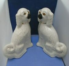 Two White Ceramic Dog Ornaments With Gold Gilt
