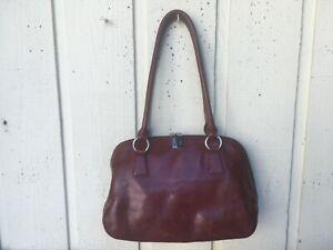 Hobo International women's genuine leather Satchel Handbag. Brown, glossy.