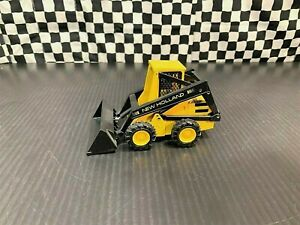 NZG New Holland L-555 Skid-Steer Wheel Loader -Yellow/Black- 1:25 Diecast Boxed