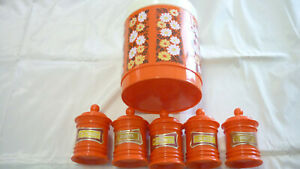 1960's ORANGE PLASTIC/WHITE DAISIES BISCUIT CANISTER & 5 HERB/SPICE CANISTERS