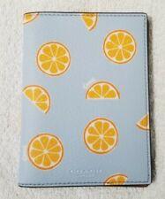 Coach Women's Orange Print Signature Canvas Passport Case in orange/blue - nwt