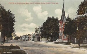 H63/ Crown Point Indiana Postcard c1910  First M.E. Church Main Street Stores 53
