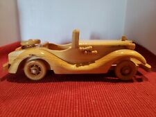 Vintage Carved Wood Automobile Model Car with Spare Tire, Horns and Headlights.