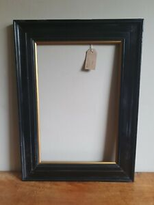 Antique  ebonised frame with gilt slip