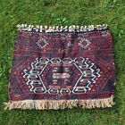 Antique flatware bag face rug.
