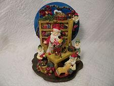 Vintage Musical Santa's Toy Shop wth turning wheel that plays Jingle Bells.