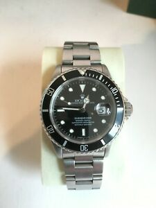 Rolex Submariner Date 16610, Black Dial, Stainless Steel, Box and Papers, 1995.