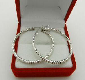 "14k White Gold Diamond Cut Hollow Earrings 1.25"" in diameter 3.2 grams"