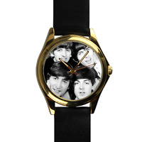 The Beatles Watch John Lennon, Paul McCartney, George Harrison and Ringo Starr