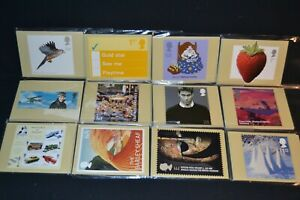 GB phq cards 2003 period x 12 different sets all with stamps on the back & fdi