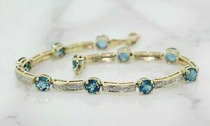9.13ct Round Cut Blue Topaz and Diamond 14K Yellow Gold Over Tennis Bracelet