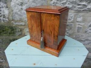 An Antique Miniature Cabinet. Walnut & Inlay. 2 Doors & 3 Draw  Lock & Key (350)