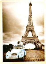 POSTCARD OF LOVERS IN A CAR AT BASE OF EIFFEL TOWER