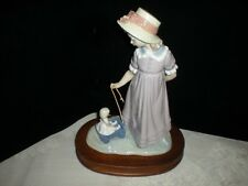 Lladro #5044 Girl With Toy Wagon Pulling Doll Carriage. No Box or Base.
