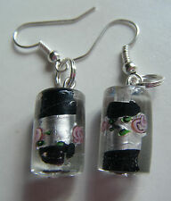 SILVER FOIL LAMPWORK GLASS CYLINDER EARRINGS WITH BLACK INSERT & FLOWER DESIGN.