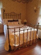 brass bedturn of the century bed w curved front cannon balls