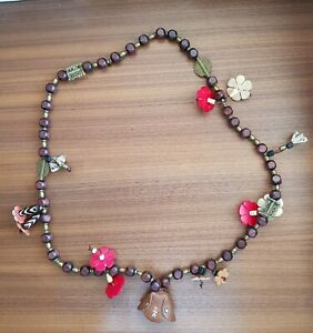 Henry Beguelin branded handmade necklace in brown wood, brass and leather