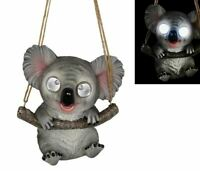 40CM HANGING KOALA HANGING ONTO A BRANCH SOLAR EYES THAT LIGHT UP SOLAR PANEL