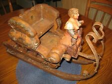 Antigue hand carved painted wood metal sleigh with semi clothed woman and 2 dogs