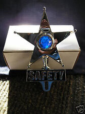 VINTAGE STYLE SAFETY STAR WITH A BLUE GLASS JEWEL IN THE CENTER THAT LIGHTS UP 3