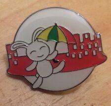 Rabbit with an Umbrella novelty pin badge.