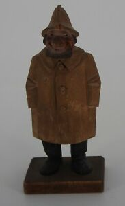 Man with hands in pockets wood figure by Trygg