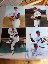 4 Autographed Nolan Ryan 8x10`s in all four uniforms