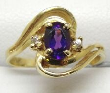 14k YELLOW GOLD DIAMONDS AND OVAL AMETHYST RING