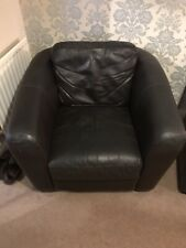 2 brown leather armchairs. Really nice and comfy.