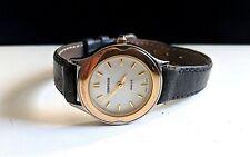 Vintage Ladies Quartz Wristwatch Cosmopolitan Pink gold bezel on SS TM Hearst.