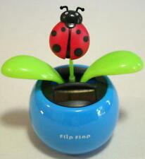 New listing Solar Flower Toy Ladybug on a Blue Pot