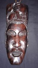 Hand carved strong and brown Ebony wood mask and Elephant attached.