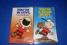 2 VHS Kartes Charlie Brown Videos You're A Good Sport & You're In Love  c4