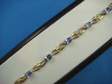 14K YELLOW GOLD 5 CT T.W. TANZANITE LADIES BRACELET, 9.8 GRAMS, 7 INCHES LONG