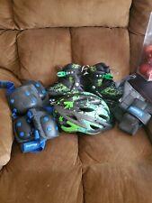Adjustable green and black roller blades, knee/elbow pads, hand gaurds, helmet