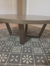 Round coffee table, modern grey tone wood effect