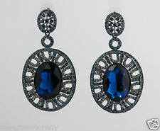 Shay gunmetal Swarovski large oval earrings with blue Sapphire stones