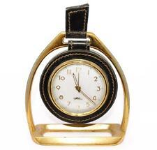 Pendule de voyage Longchamp bronze et cuir cousue Étrier vers 1960.