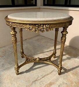 Superbe GUÉRIDON Louis XVI en bois doré et marbre, sculpté et orné de feuillages