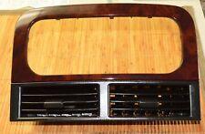 1999-04 Jeep Grand Cherokee Dash Radio Bezel  Vents Black / Woodgrain OEM Used
