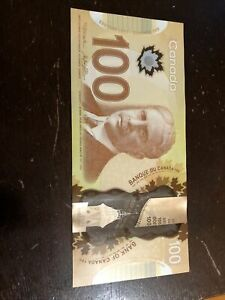 Canadian 100 Dollar banknote - with tracking.