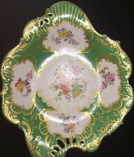 This is an 1830 to 1860s Rockingham, Coalport of Minton of England green dessert