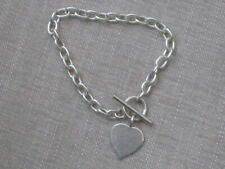 Heavy silver chain bracelet with heart charm