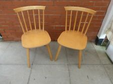 A Pair Of Beech Wood Dinning Chairs