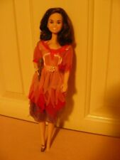 Marie Osmond Doll - wearing pink & purple dress; with microphone; 1976