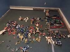 Power Rangers lot with plenty of Morphers, Megazords, figures, weapons, and more