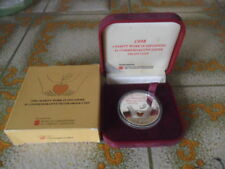 1998 Charity Work in Singapore $5 Silver Proof Coin with Gold insert
