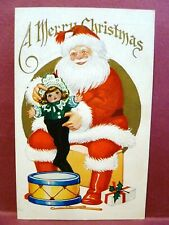 Postcard Christmas Santa Stuffing a Doll in a Black Stocking