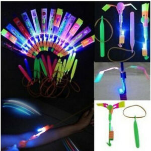 10 Pcs Arrow Rocket Copters LED Light Helicopter Flying Toy Elastic Powered