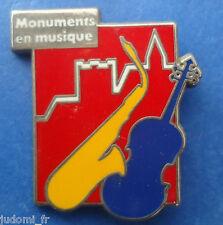 Pin's pin MONUMENTS EN MUSIQUE SAXOPHONE VIOLON (ref H34)